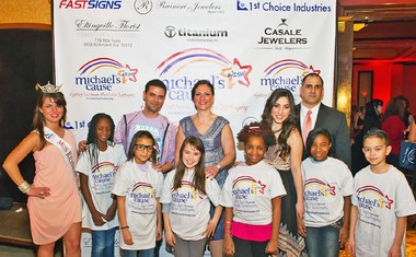 """Among the adults who attended the Michael's Cause fundraiser were, from the left, Alyssa Depaolis, Miss Richmond County 2013; Greg Breinberg, director of the PS 22 Chorus with some of his students; Theresa Capolongo; Brielle Von Hugel, an """"American Idol"""" finalist in 2011, and Robert Capolongo. Photo Courtesy of Joe Larusso"""