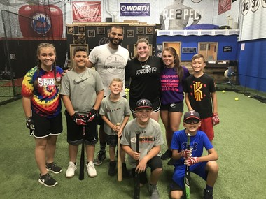 Juan Camacho, a former Staten Island Yankee, and co-owner of Clutch Hitting of Staten Island Inc. with his students. (Staten Island Advance/Tracey Porpora)