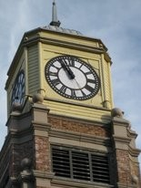 This prominent clock tower in Tompkinsville crowns old PS 15, at 95 Grant St.