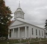 Woodrow United Methodist Church features four Doric columns.