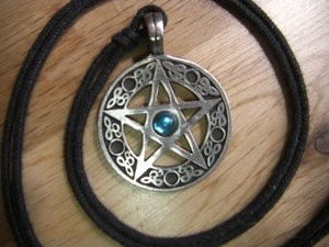 A pentacle worn as a pendant is shown in this stock image.