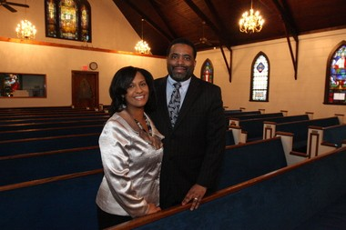 The Rev. Alfredo Archibald, pastor of Fellowship Baptist Church, and his wife Lajuana, are pictured inside the Mariners Harbor church.