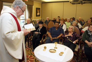 Monsignor Philip Franceschini, pastor of Our Lady Of Pity R.C. Church, celebrates mass at the Esplanade Independent Living Facility in Bulls Head. He plans to say mass at the assisted living facility once a month, as well as conducting special services for holidays.