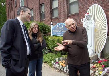 Peter and Gabriella Malara, discuss plans for the 20th anniversary mass with Brother Aloysius Milella, an early supporter of the chapel, who has returned to the Society of St. Paul in time for the celebration.