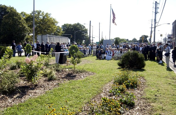 Guests gather for Concord's Healing Garden dedication in 2003. The site includes 78 purple fringe trees, also known as smoke trees, planted in memory of the 78 Staten Island firefighters who died responding on 9/11.