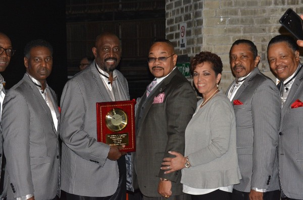 The Temptations recieve a plaque from the Richmond County Black & Minority Chamber of Commerce for their 50 years in the entertainment industry on May 10, 2018. (Courtesy of Serena Robinson)