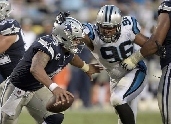 Dallas quarterback Dak Prescott feels the heat in last week's game against Carolina.
