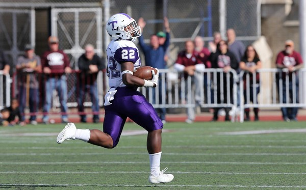 Running back Roland Dempster has what it takes to carry the load for the Tottenville HS football team, but he doesn't mind sharing the wealth.