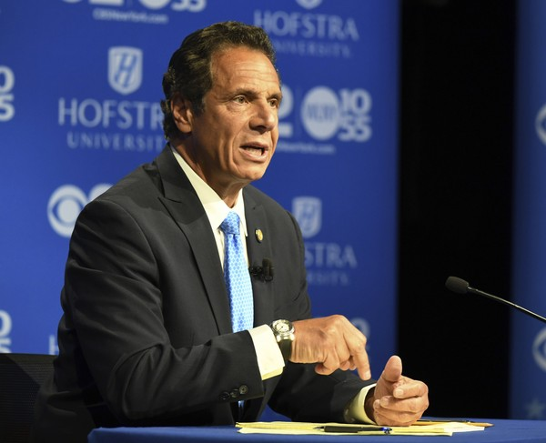 New York Gov. Andrew M. Cuomo speaks at the Democratic gubernatorial primary debate, Wednesday Aug. 29, 2018, at Hofstra University in Hempstead, N.Y. Cuomo says he'll serve a full four years and not seek the White House in 2020 if he's elected to a third term. (J. Conrad Williams Jr./Newsday via AP, Pool)