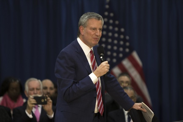 De Blasio plans to diversity the city's specialized high schools by eliminating the Specialized High Schools Admissions Test over the next three years and reserving 20 percent of seats in elite schools to low-income students who just missed the test cut-off starting in September 2019.