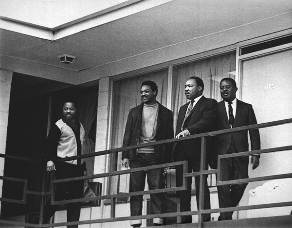 In this April 3, 1968, file photo, the Rev. Martin Luther King Jr. stands with other civil rights leaders on the balcony of the Lorraine Motel in Memphis, Tenn., a day before he was assassinated at approximately the same place. From left are Hosea Williams, Jesse Jackson, King, and Ralph Abernathy. (AP Photo, File)