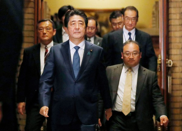 """In this May 28, 2018 photo, Japanese Prime Minister Shinzo Abe walks out from his official residence to meet journalists after talking on the phone with President Donald Trump in Tokyo. The White House says President Donald Trump and Japanese Prime Minister Shinzo Abe plan to meet in advance of the """"expected meeting"""" between Trump and North Korea's leader. (Keizaburo Fukuhara/Kyodo News via AP)/Kyodo News via AP)"""