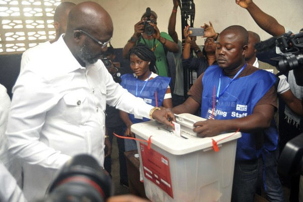 Former Staten Islander and soccer star George Weah casts his vote during the presidential runoff election in Monrovia, Liberia, Tuesday Dec. 26, 2017. (AP Photo/Abbas Dulleh)