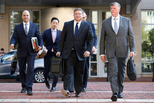 The defense team for Paul Manafort, including Kevin Downing, right, and Jay Nanavati, far left, walks to federal court as the trial of the former Trump campaign chairman continues, in Alexandria, Va., Thursday, Aug. 9, 2018. (Associated Press)