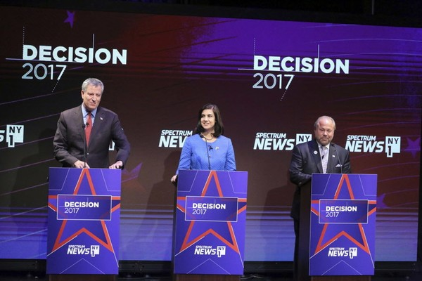Mayor Bill de Blasio, Republican mayoral candidate Nicole Malliotakis and independent candidate Bo Dietl debate at Symphony Space on the Upper West Side on Tuesday, Oct. 10, 2017.