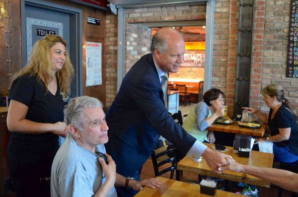 """This Advance file photo shows Rep. Daniel Donovan and Piece-A-Cake Bakery owner Maria Carrozza greeting customers in New Dorp. Donovan is hosting """"Coffee with your Congressman"""" meetings this month."""