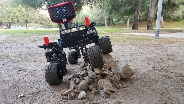 - A Jet Propulsion Laboratory-built Open Source Rover example, showing off the rocker-bogie suspension as it rolls over a pile of rocks. (Photo courtesy of NASA/JPL-Caltech)