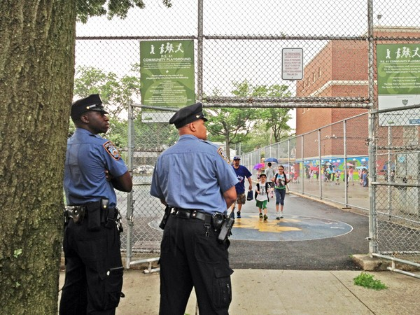 City schools leave front doors unlocked, as parents push for tighter security protocols in public schools. In this file photo, school safety officers stand outside PS 41, New Dorp, at dismissal. (Advance file photo)