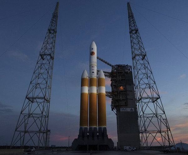 "The United Launch Alliance Delta IV Heavy rocket with the Parker Solar Probe aboard is seen Friday at Launch Complex 37 at Cape Canaveral. NASA is sending a spacecraft straight into the sun's glittering crown. ""We're going to explore unknown territory,"" says Marco Velli, the probe's observatory scientist. Bill Ingalls, NASA AP"