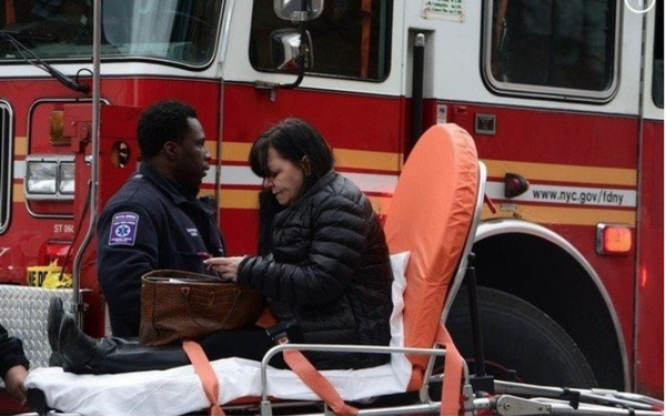 Dorothy Bruns of Concord is treated following the fatal crash in Brooklyn. (Photo courtesy of Todd Maisel/New York Daily News)