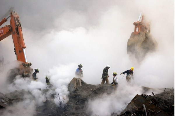 Firefighters make their way over the ruins of the World Trade Center through clouds of smoke at Ground Zero in this Thursday, Oct. 11, 2001 file photo, in New York. The government fund established to aid those with health issues caused by time spent near Ground Zero is set to expire in 2020. (AP Photo/Stan Honda, Pool)
