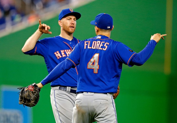 New York Mets third baseman Todd Frazier, left, and first baseman Wilmer Flores celebrate after their victory over the Miami Marlins in a baseball game in Miami, Sunday.