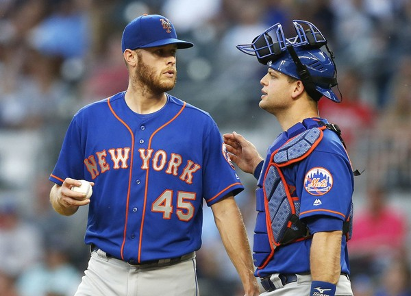 Pitcher Zack Wheeler #45 of the New York Mets talks with catcher Devin Mesoraco #29 in the third inning during the game against the Atlanta Braves at SunTrust Park on June 12, 2018 in Atlanta, Georgia. (Photo by Mike Zarrilli/Getty Images)