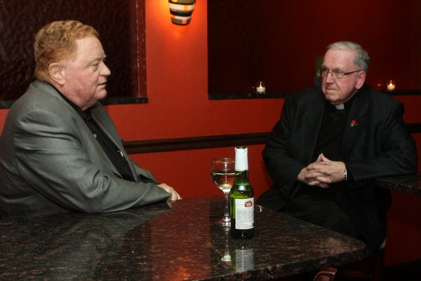 Former Met Rusty Staub talks with Monsignor Peter Finn before the start of Project Hospitality Annual Poor People's Dinner in 2013.
