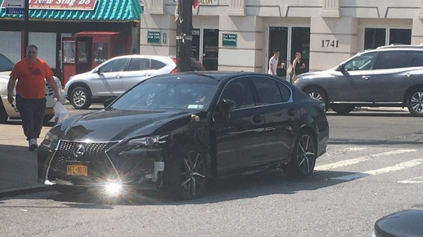 A car with damage to its front driver side can be seen at Victory Boulevard and Winthrop Place in Castleton Corners.