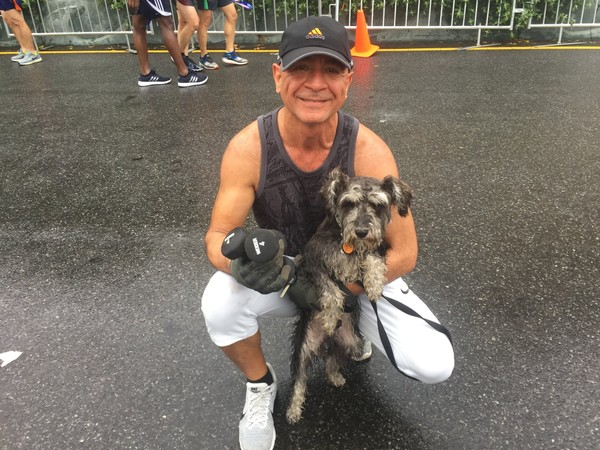 Staten Island resident Jim Shrayef with his dog Teddy at the finish line of Sunday's Staten Island Half-Marathon.