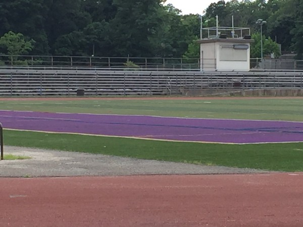 A youngster plunged 15 feet through the spacing beneath the Tottenville High School bleacher rows to the ground below, a lawsuit alleges.