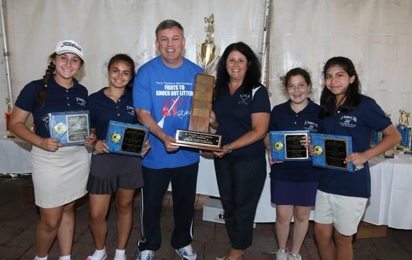 Teddy Atlas Jr., middle left, hands out awards to a recent team from St. Joseph Hill during the Dr. Theadore A. Atlas Memorial CYO Grammar School Jr. Golf Tournament.