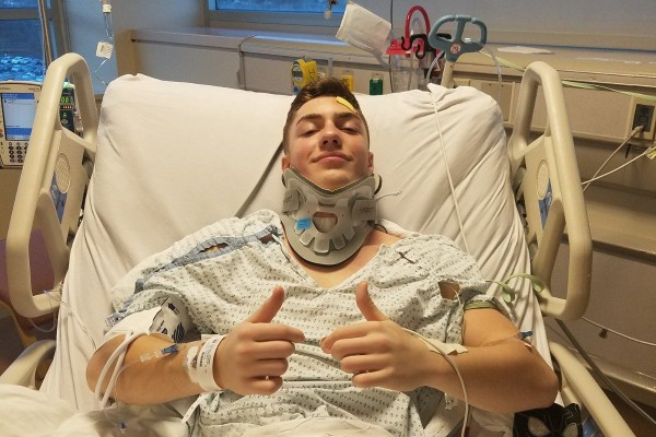 St. Peter's senior Michael Wright gives a thumbs-up sign from his Staten Island University Hospital bed earlier this week.