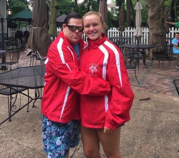 Kathleen Bridgeman with one of her swimmers at the Special Olympics summer swim meet at Hillside Swim Club.