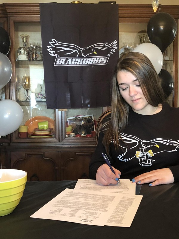 Jacqualyn Ciprello signing the dotted line to attend LIU Brooklyn in the fall and play on the bowling team.