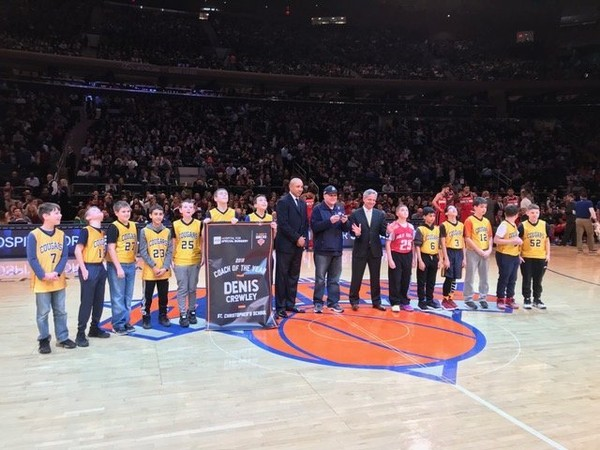 Denis Crowley accepting his award alongside his St. Christopher's sixth grade boys' basketball team, former New York Knick John Starks, and a representative from the Hospital for Special Surgery.