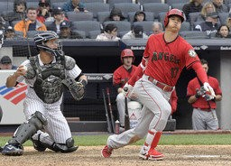 Los Angeles Angels' Shohei Ohtani (17) strikes out as New York Yankees catcher Gary Sanchez, left, looks on during the sixth inning of a baseball game Sunday, May 27, 2018, at Yankee Stadium in New York. (AP Photo/Bill Kostroun)
