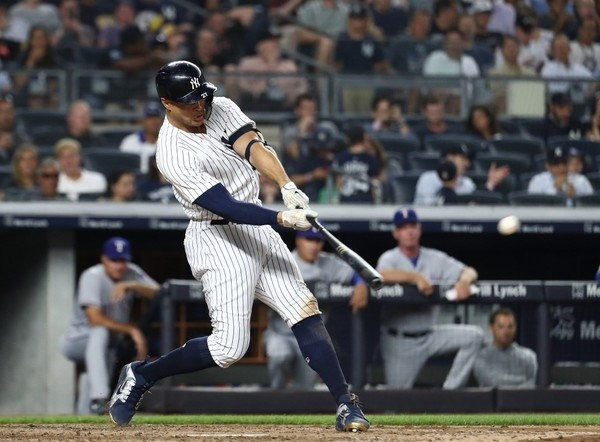 Giancarlo Stanton #27 of the New York Yankees hits a fifth inning home run against the Texas Rangers during their game at Yankee Stadium on August 9, 2018 in New York City. (Al Bello | Getty Images)