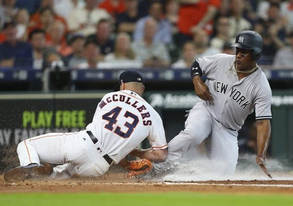 Miguel Andujar #41 of the New York Yankees is tagged out by Lance McCullers Jr. #43 of the Houston Astros attemptig to score in the second inning at Minute Maid Park on May 3, 2018 in Houston, Texas. (Bob Levey   Getty Images)