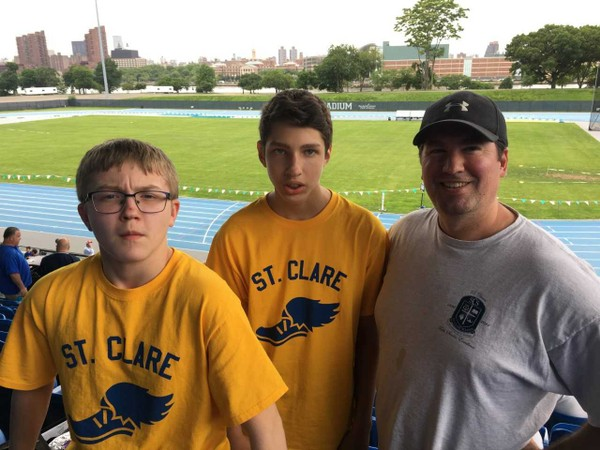 John Rapacciuolo with his two sons, Enzo (left) and Nicholas (middle) at the Archdiocesan championships at Icahn Stadium.