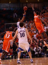Syracuse's Hakim Warrick blocks Kansas' Michael Lee with less than a second left in the 2003 national title game in New Orleans.