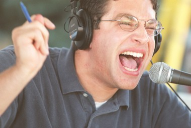 Adam Schein, then with WHEN in Syracuse, broadcasts his show with all his energy at the 1999 New York State Fair.