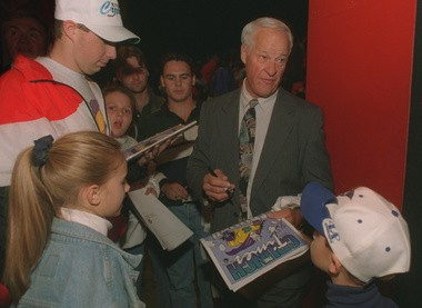 Hockey legend Gordie Howe signs autographs at the Syracuse Crunch's first-ever home opener on Sept 30, 1994 at the Onondaga County War memorial.