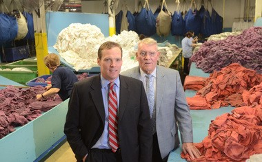 Marty Coyne, then president and CEO of Coyne Textile Services, and his father, Thomas Coyne, then chairman of the company, pose for a picture in the company's plant in Syracuse in 2012.