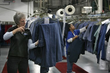 Bonny Hutchinson, left, and Maryjo Sanders, right, work in the garment assembly area of Coyne Textile Services in Syracuse in 2010.