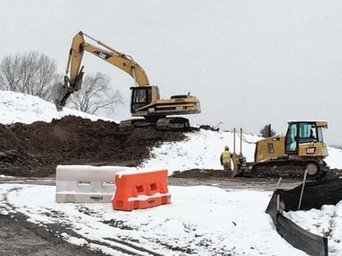 An excavator and a bulldozer cut into a hill as part of the construction of a 130-unit retirement community at North Burdick Street and Medical Center Drive in Manlius. The developer, Resort Lifestyle Communities, is seeking tax breaks for the project.