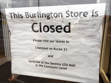 A sign left at the entrance to the Burlington store at Driver's Village in Cicero says the store is closed and urges shoppers to visit Burlington's store in Clay and Syracuse.