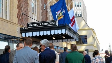 Workers, politicians and others gather outside the former Hotel Syracuse on Friday, Aug. 19, 2016 for the official reopening of the 92-year-old hotel at South Salina Street and East Onondaga Street. It will now be called the Marriott Syracuse Downtown.
