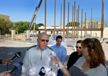 Syracuse University basketball coach Jim Boeheim visits the #BLVD404 apartments construction site at 404 University Ave. on Sept. 23, 2015. Boeheim was an investor in the project, which has been sold to American Campus Communities Inc. and renamed U Point.
