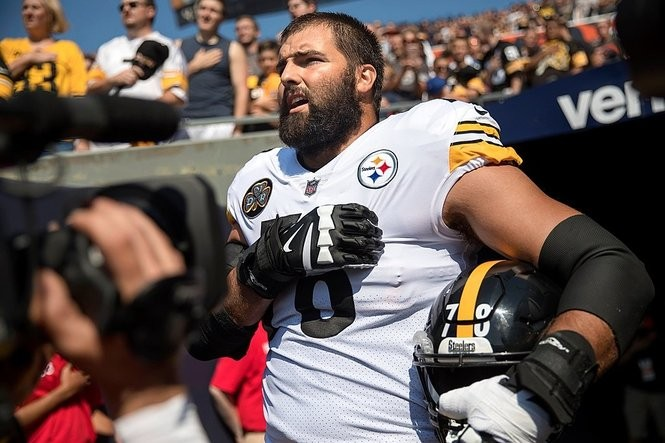 Pittsburgh Steelers offensive tackle Alejandro Villanueva (78) is the sole member of the team to stand in the open for the national anthem while his teammates remained in the tunnel before a game against the Chicago Bears on Sunday, Sept. 24, 2017, at Soldier Field in Chicago, Ill. (Erin Hooley/Chicago Tribune/TNS)